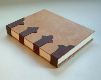 Elegant handmade blank book, case-bound in dark brown calfskin and wood. Journal, diary, sketchbook.