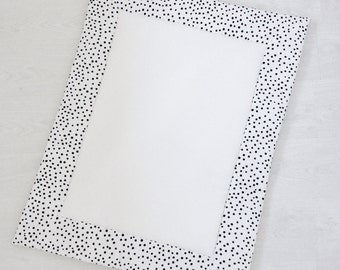 White baby playmat with black & white dot print