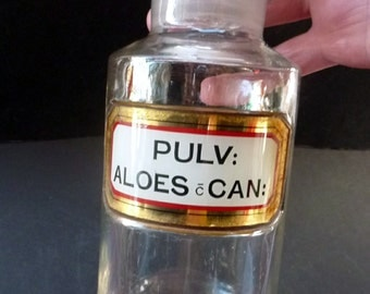 Lovely Antique Clear Glass Chemist Bottle: PULV ALOES CAN with Original Foil Label and Ball Stopper