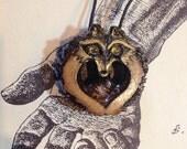 Racoon Eyes- Carved black walnut raccoon with peridot eyes