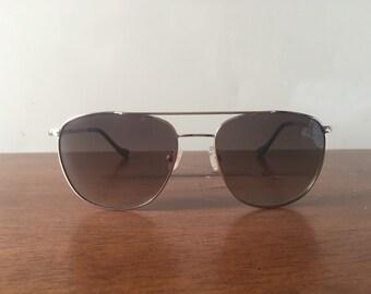 Gold rim, green accent sun glasses