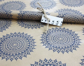 single sheet of wrapping paper, hand printed brown paper gift wrap, circle patterns in blue on 75 x 50 kraft paper