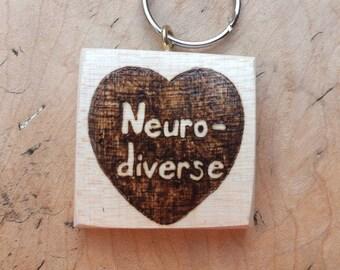 Neuro-diverse pride hand-pyrographed wooden keyfob