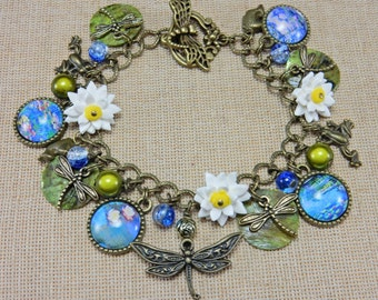 Dragonfly bracelet with Waterlilies, Lily pads and Monet print cabachons. Handmade