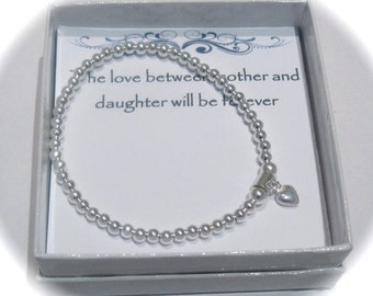Daughter Sterling Silver puffed heart Stretch Bead Bracelet