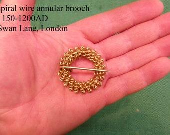 medieval spiral wound annular brooch swan lane london find 1150-1200AD