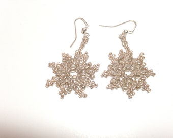 Sand colored glass beaded earrings in a Snowflake pattern