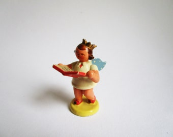 Vintage wooden angel figure with crown and song book, Erzgebirge, GDR era German Christmas decoration, collectible figure
