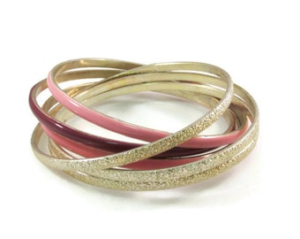 Intertwined Textured Gold Tone and Pink and Purple Enamel Bangles, Rolling Bracelet