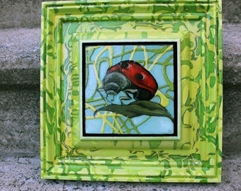 Green Framed Lady Bug Painting