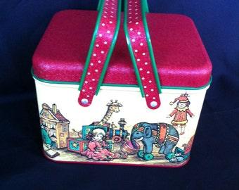 A Decorative Tin With Handles And Toy Design By Potpourri Press Made In USA