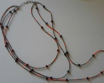 Three strand orange grey and black beaded necklace