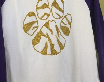 Glitter paw print tiger raglan T.  Can be customized color