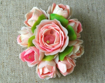 Vintage rose bouquet brooch with realistic petals and crystal bead interior.