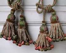 One pair antique french curtain tie backs with tassles. Set of 2 curtain tie ropes with tassles. Green and pink. Extra large. Passementerie