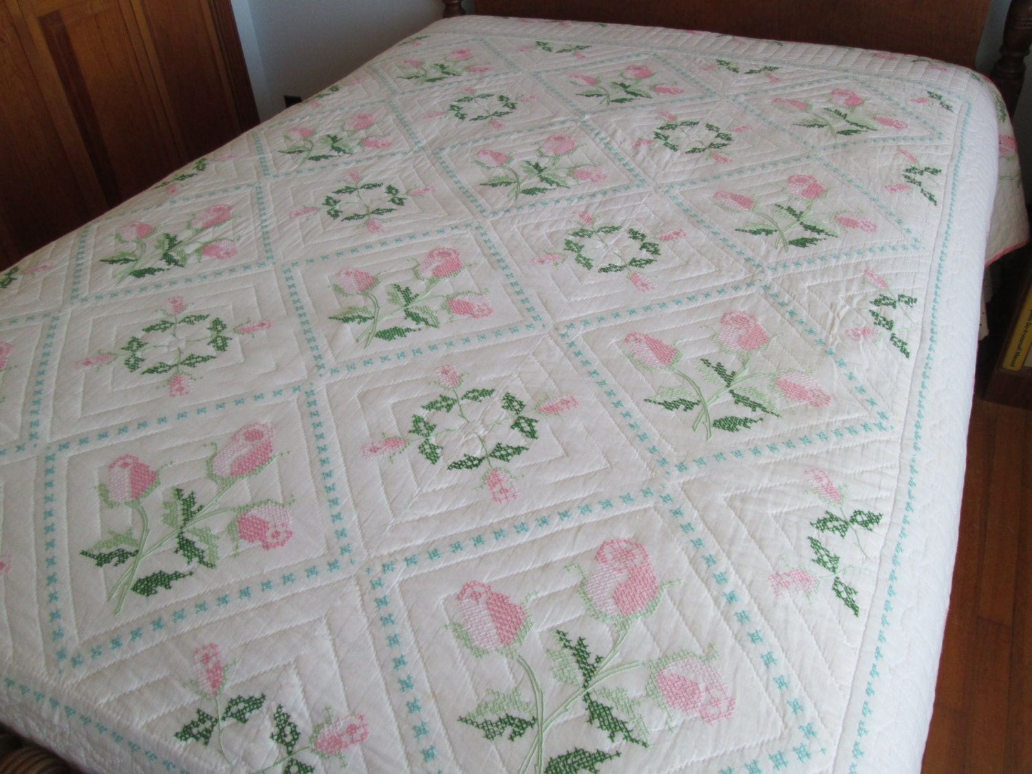 Full sized hand embroidered pink roses quilt