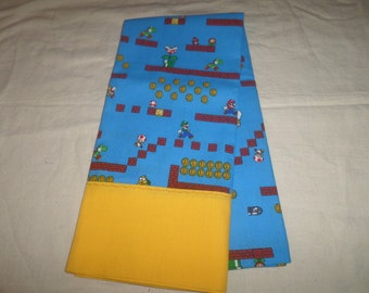 pillowcase made from Mario Brothers video game screen blue cotton fabric with gold trim