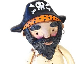 Pirate in Black and Orange folk art sculpture