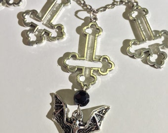 Inverted cross bat necklace