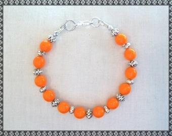 orange bracelet, bright orange bracelet, silver bracelet