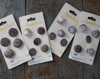19 vintage silver buttons, sewing supplies, matching flowered buttons, sewing notions, jewelry making, original manufacturers card. (B23)