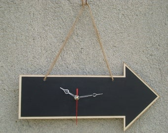 Wall clock made from wood, the table has a blackboard effect where you can write with chalk