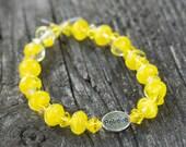 """Yellow glass beaded stretch bracelet with """"Believe"""" charm"""