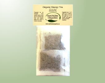 Orange and Green Tea Herbalist Prepared From Certified Organic Herbs