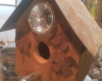 Rusty flowers birdhouse