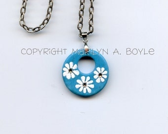 REDUCED- HAND PAINTED Stone; turquoise blue,circular,3 white daisies, three Swarovski crystals, jewelry, pendant, 16 inch, flowers,