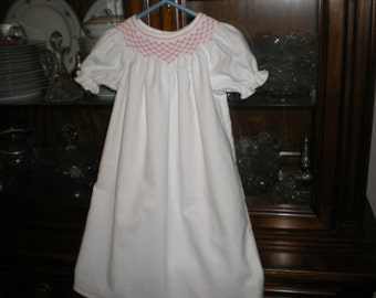 smocked baby gown in swiss flannel