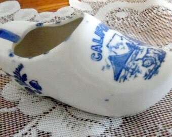 "Small blue and white Dutch Shoe ashtray, a souvenir from California.  4"" long and 2"" tall."