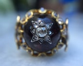 Garnet starburst ring, Victorian era, Renaissance Revival, rose-cut diamonds, 18k body and 10k band