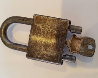 Rare early Master Lock Co. adjustable padlock with key, marked 416