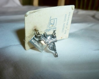 Sterling Silver Charm Horse Saddle, 3 dimensional saddle. New, On original card, Bell of Albuquerque store logo. Denver CO, 1978