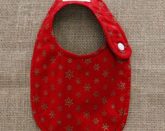 Red Cloth Baby Bib With Gold Snowflakes