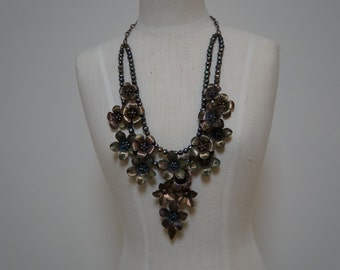 Double tiered pearl and flower necklace.