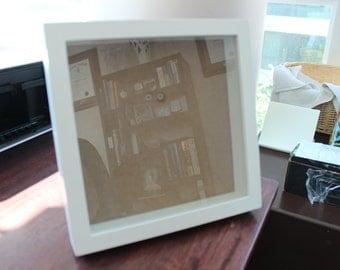 white frame shadow box