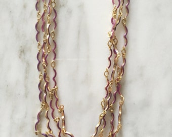 Necklace with strands of enameled vintage chains