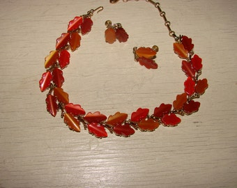 Classic SET Lisner choker style necklace and screw back earrings.  Great cab Lucite fall colored leaves surrounded by gold tone metal.