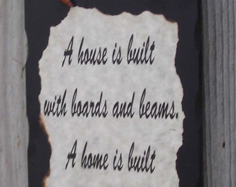 Wooden sign, A house is built with boards and beams. A home is built with love and dreams. 6 inches X 9 Inches