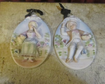 A Pair of Victorian Children's Wall Plaque