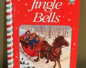 """Vintage 1995 """"Jingle Bells"""" childs book by Carolyn Quattrocki, Linds Graves, Susan Spellman, Publications International, and Candy Cane Book"""