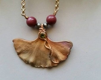 Bronze ginkgo leaf necklace.