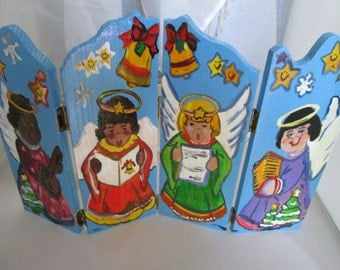 Angel folding decorative painted plaques, signed Tole design. Carefully hand painted, bright colors.