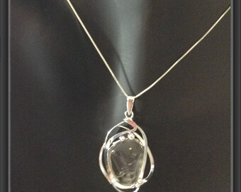 Smokey quartz pendant wrapped in silver platted copper