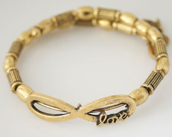 "Clearance ~ AA6706A  Heavy 9 1/2"" Gold Tone Coil Bracelet + 1 3/4"" Extender With Infinity/Love in Middle + 3 Small Charms on End"