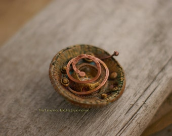 Brooch in the steampunk style