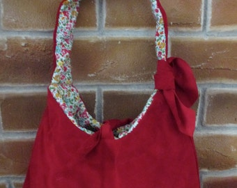 Red suede handbag