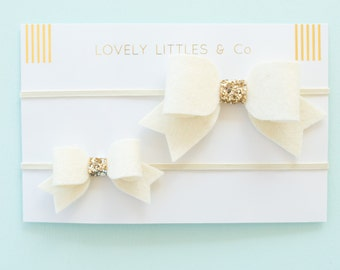 Big Sister / Little Sister matching hairband set. Cream and gold felt bow on skinny elastic.